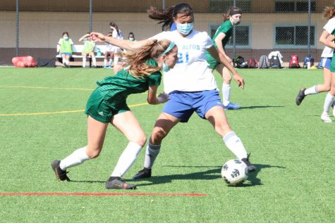 Freshman midfielder Josie Vogel attempts to steal the ball from an Eagle.