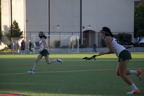 Junior Anika Chang rushes for the ball.