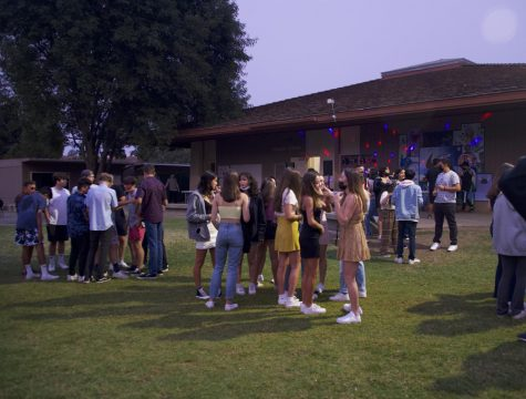 """Students meet Friday evening on the Quad at Palo Alto High School's Welcome Back dance.  """"I've been looking forward to going with my friends and it seems really fun, the energy is really nice,"""" sophomore Lucy Li said. (Photo: Jonathan Chen)"""