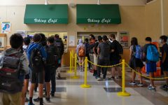 """Students line up to receive free lunch from the cafeteria in the Student Center at Palo Alto High School. The Palo Alto Unified School District has been offering lunch for free to students due to a requirement from the state government. Freshman Divij Motwani, who eats free lunch on a daily basis, said the option helps those in need. """"It [free lunch] wouldn't really have changed [things] to me, but I think it's good for everyone else, especially because there's some people who can't afford lunch,"""" Motwani said. (Photo: Neil Rathi)"""