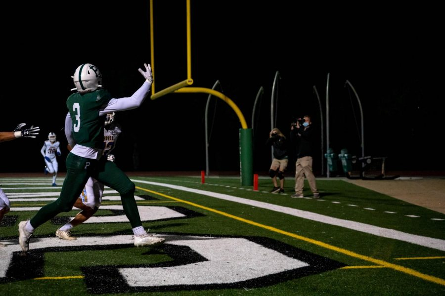 Junior wide receiver and defensive back Amani Elfadil jumps for the ball in the Padres end zone. (Photo: Ryan Lee)