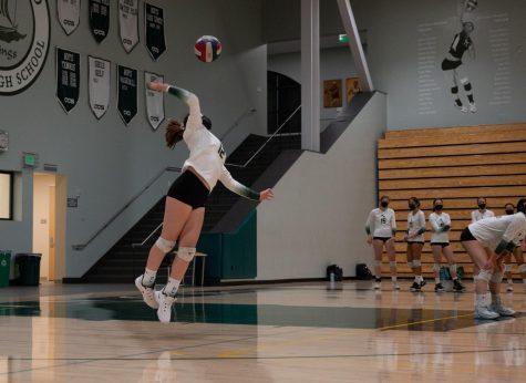 Freshman Sophie Mies serves the ball.