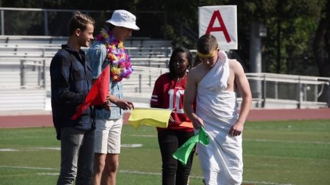 """Four Paly students are dressed up for Salad Dressing Day. From left to right: Cowboys, Thousand Island, Sports Wear, and Togas. This photo was taken in 2019, when the Thousand Island theme was still """"Beach Day."""" """"It was originally just a beachwear but people morphed it into a Hawaiian Day,"""" said Junior Class President Ashley Hung. Photo by Ethan Chen."""